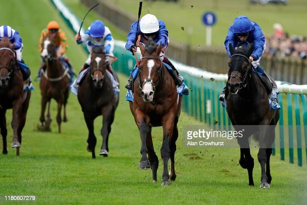 Oisin Murphy riding Military March win The Dubai Autumn Stakes fromAl Suhail and William Buick at Newmarket Racecourse on October 12, 2019 in...