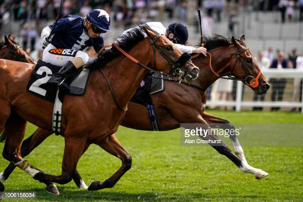 Oisin Murphy riding Production win The Anders Foundation British EBF Crocker Bulteel Maiden Stakes at Ascot Racecourse on July 27, 2018 in Ascot,...