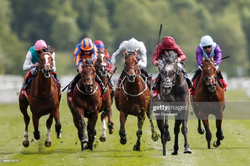Oisin Murphy riding Roaring Lion (2R, maroon) comfortably win The Betfred Dante Stakes at York Racecourse on May 17, 2018 in York, United Kingdom.