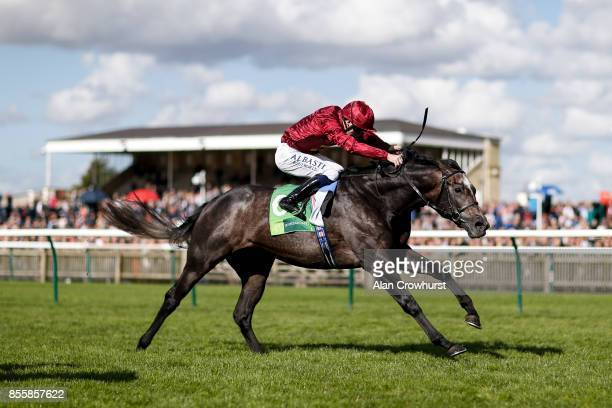 Oisin Murphy riding Roaring Lion win The Juddmonte Royal Lodge Stakes at Newmarket racecourse on September 30 2017 in Newmarket United Kingdom