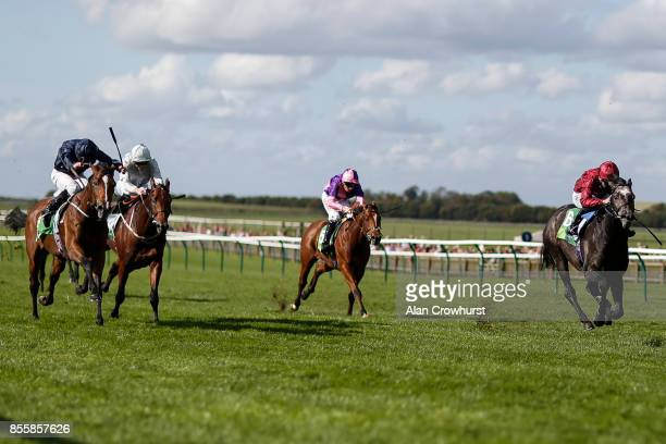 Oisin Murphy riding Roaring Lion win The Juddmonte Royal Lodge Stakes from Nelson at Newmarket racecourse on September 30 2017 in Newmarket United...