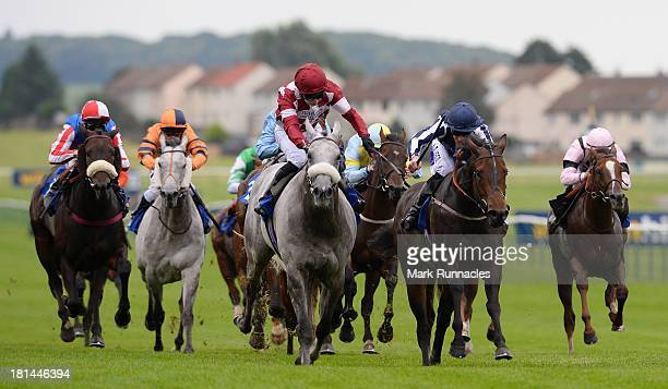Oisin Murphy riding Silver Rime wins the Microtech Support Handicap Stakes at Ayr racecourse on September 21 2013 in Ayr Scotland