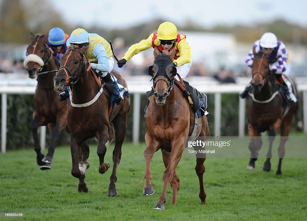 Oisin Murphy riding Soaring Spirits (yellow and red silks) wins The Universal Recycling Apprentice Handicap Stakes race from Lazarus Bell during the Racing Post Trophy Meeting at Doncaster Racecourse on October 26, 2013 in Doncaster, England.
