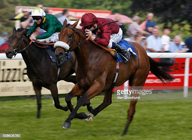 Oisin Murphy riding White Poppy win The EBF Stallions Breeding Winners Margadale Fillies' Handicap Stakes at Salisbury racecourse on June 7 2016 in...