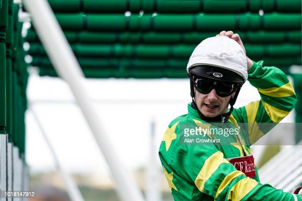 Oisin Murphy sits in the stalls at Newbury Racecourse on August 17 2018 in Newbury United Kingdom