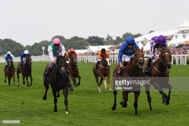 Oison Murphy on Benbatl wins the Hampton Court Stakes from Ryan Moore on Orderofthegarter on Day Three of Royal Ascot at Ascot Racecourse on June 22...
