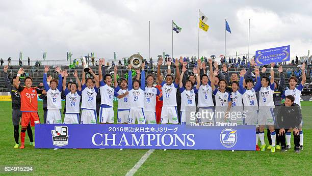 Oita Trinita players celebrate winning the third division title and promotion to the second division after the J.League third division match between...
