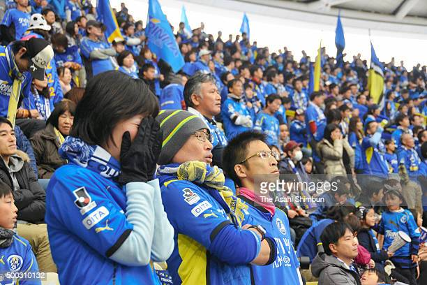Oita Trinita supporters show their dejection as their team relegate to J3 after the JLeague J2/J3 PlayOff second leg match between Oita Trinita and...