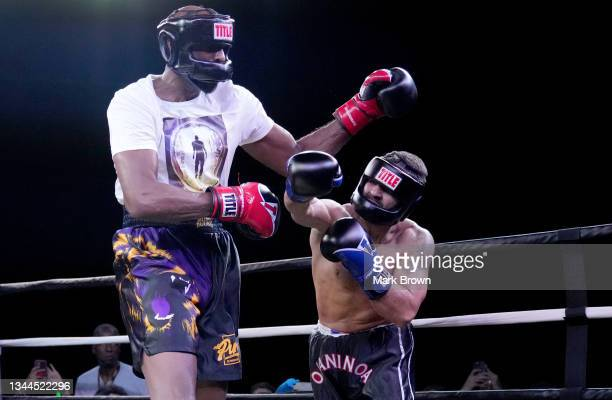 Ojani Noa throws a punch at Lamar Odom in the third round during Celebrity Boxing Miami 2021 Lamar Odom vs Ojani Noa at the James L. Knight Center on...