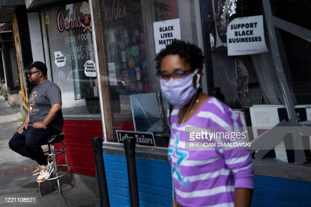 "Oji Abbott ""Chef O"" sits in front of his restaurant Oohh's and Aahh's, one of the many on U Street, June 15 in Washington, DC. - Media, activist and..."