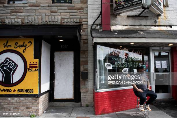 """Oji Abbott """"Chef O"""" sits in front of his restaurant Oohh's and Aahh's, one of the many on U Street, June 15 in Washington, DC. - Media, activist and..."""