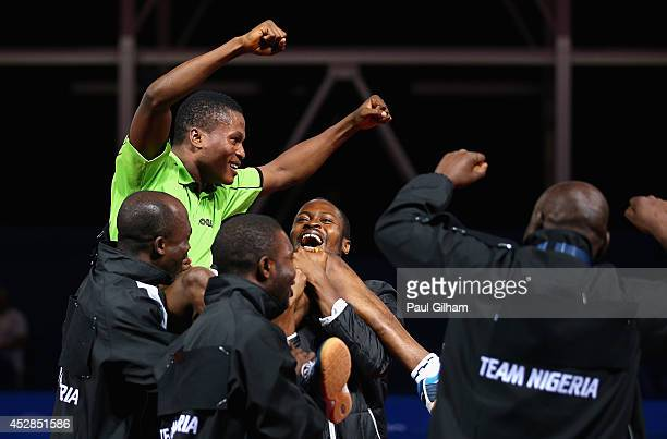 Ojo Onaolapo of Nigeria celebrates with his teammates after winning match point against Sharath Kamal Achanta of Nigeria to win the Bronze Medal for...