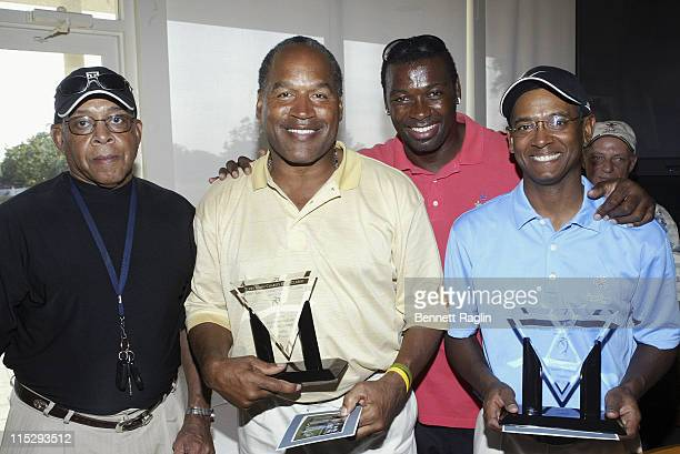 OJSimpson and team take the third place trophy during Terry Kirby's 'Touchdown for Life Foundation' Celebrity Golf Outing April 8 2006 at...