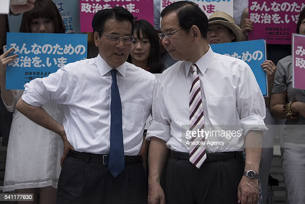 Okada Katsuya from Democratic Party and Shii Kazuo from Communist Party speak with each other during the coalition's election event before the...