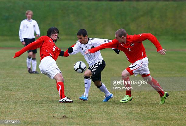 Okan Aydin of Germany fights for the ball with Christian Gartner and Philipp Posch of Austria during the U17 Euro Qualifier match between Austria and...