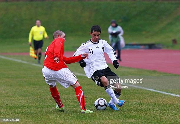 Okan Aydin of Germany fights for the ball with Philipp Posch of Austria during the U17 Euro Qualifier match between Austria and Germany at the...