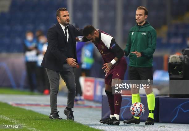 Okan Buruk Manager of Istanbul Basaksehir holds Neymar of Paris SaintGermain as he is substituted following an injury during the UEFA Champions...