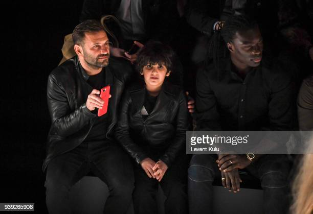 Okan Buruk with his son and Bafetimbi Gomis attend the St Nian show during Mercedes Benz Fashion Week Istanbul at Zorlu Performance Hall on March 28...