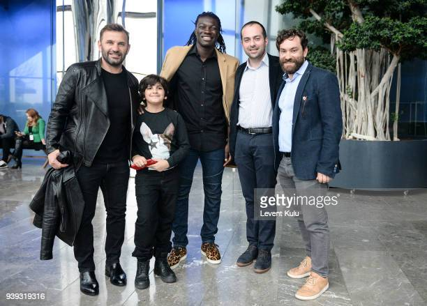 Okan Buruk with his son Bafetimbi Gomis and guests attends the St Nian show during Mercedes Benz Fashion Week Istanbul at Zorlu Performance Hall on...