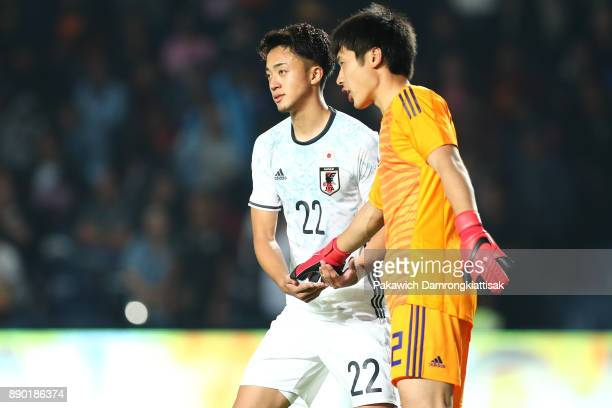Okano Jun of Japan U20 soothes Osako Keisuke of Japan U20 after his errors during the M150 Cup 2017 between Thailand U23 and Japan U20 at IMobile...