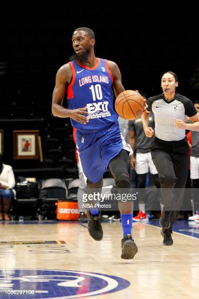 3c7c0221446 Okaro White of the Long Island Nets dribbles the ball up the court against  the Raptors