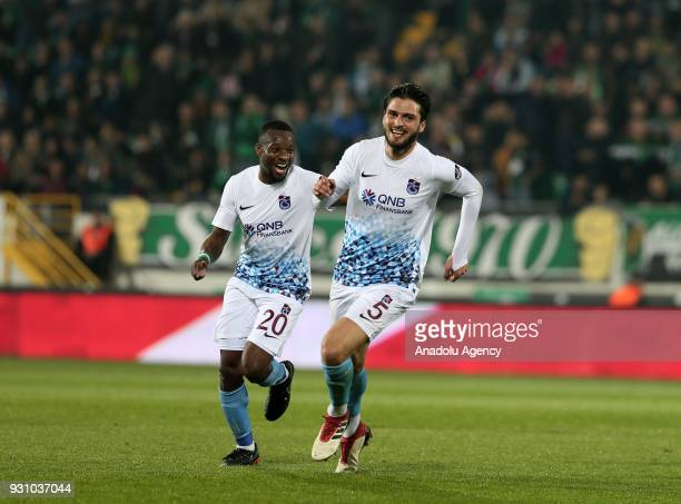 Okay Yokuslu of Trabzonspor celebrates with his teammate Eddy Onazi after scoring a goal during the Turkish Super Lig soccer match between Teleset...