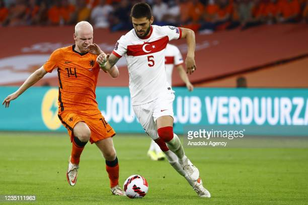 Okay Yokuslu of Turkey in action against Davy Klaassen of Netherlands during the 2022 FIFA World Cup Qualifiers Group G soccer match between...