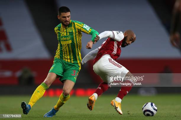 Okay Yokuslu of West Bromwich Albion and Alexandre Lacazette of Arsenal during the Premier League match between Arsenal and West Bromwich Albion at...
