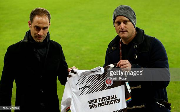 Oke Goettlich president of St Pauli and marketing director of Leipzig Oliver Minzlaff holding a jersey before the second Bundesliga match between FC...