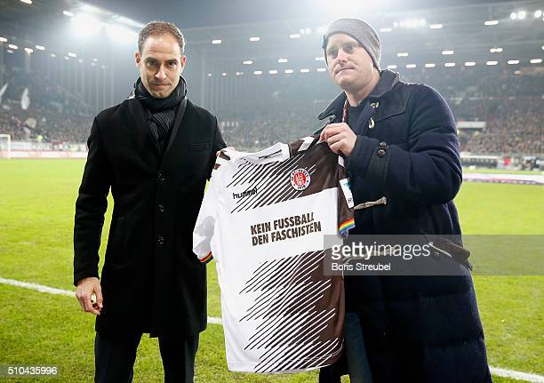 Oke Goettlich president of St Pauli and marketing director of Leipzig Oliver Minzlaff presents a special jersey against racism prior to the Second...