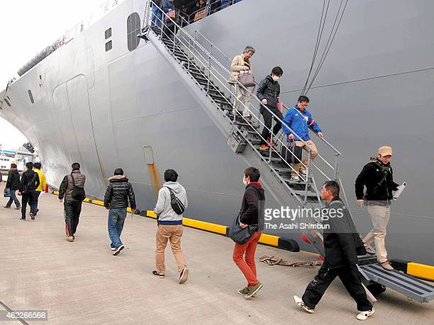 Oki island residents get off from an Japan Maritime SelfDefense Force vessel during the threeprefecture joint emergency evacuation exercise at Hakata...