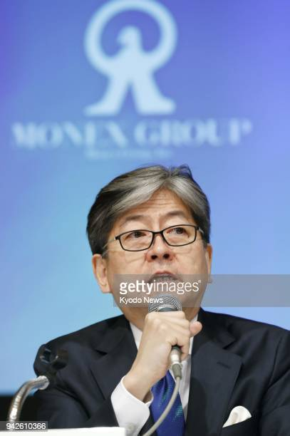 Oki Matsumoto CEO of Monex Group Inc speaks at a press conference in Tokyo on April 6 about a plan to acquire troubled cryptocurrency exchange...