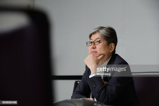 Oki Matsumoto chief executive officer of Monex Group Inc listens during an interview in Tokyo Japan on Tuesday May 8 2018 Under new leadership after...