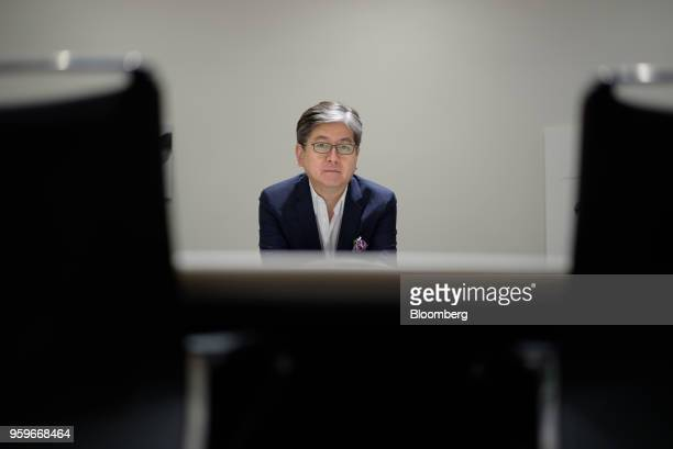 Oki Matsumoto chief executive officer of Monex Group Inc poses for a photograph in Tokyo Japan on Tuesday May 8 2018 Under new leadership after a...