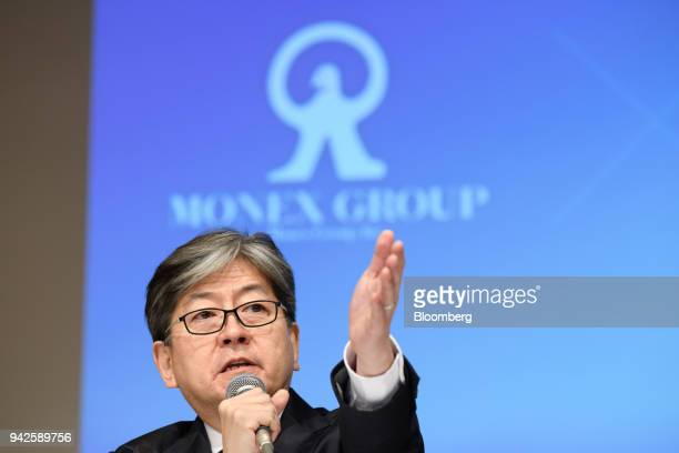 Oki Matsumoto president and chief executive officer of Monex Group Inc gestures while speaking during a news conference in Tokyo Japan on Friday...