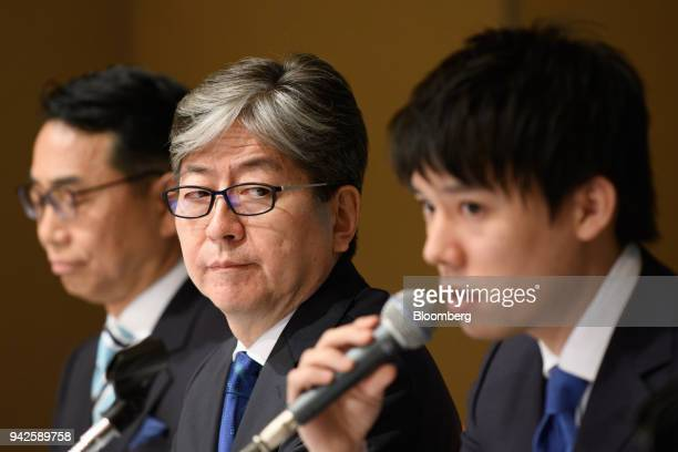 Oki Matsumoto president and chief executive officer of Monex Group Inc center looks towards Koichiro Wada president of Coincheck Inc right as he...