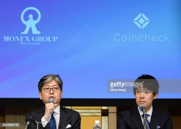 Oki Matsumoto president and chief executive officer of Monex Group Inc left speaks next to Koichiro Wada president of Coincheck Inc during a news...