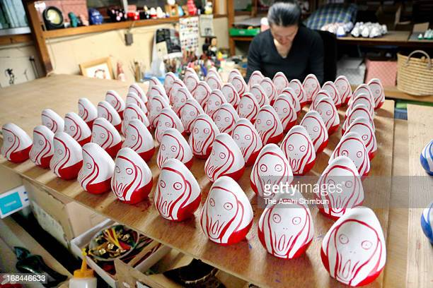 'Okiagari Munch' dolls production is in full swing at a factory on April 26 2013 in Nishiaizu Fukushima Japan The dolls are producted as the...