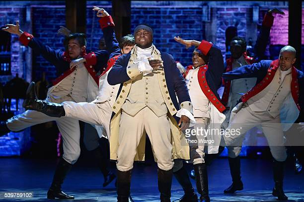Okieriete Onaodowan and the cast of 'Hamilton' perform onstage during the 70th Annual Tony Awards at The Beacon Theatre on June 12 2016 in New York...