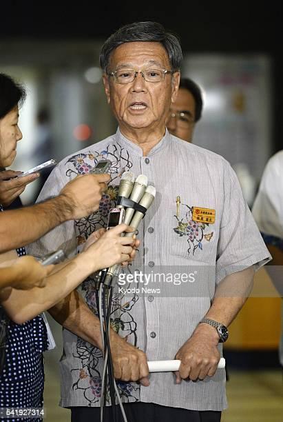 Okinawa Gov Takeshi Onaga meets with reporters at the Foreign Ministry in Tokyo on June 21 after submitting a request demanding a drastic review of...