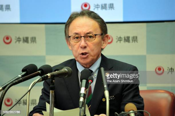 Okinawa Prefecture Governor Denny Tamaki speaks during a press conference at the Okinawa Prefecture headquarters on December 14 2018 in Naha Okinawa...