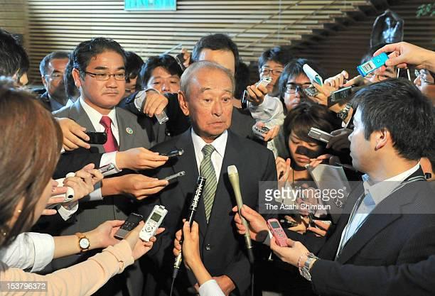 Okinawa prefecture governor Hirokazu Nakaima speaks to the media reporters while Ginowan City Mayor Atsushi Sakima looks on after their meeting with...