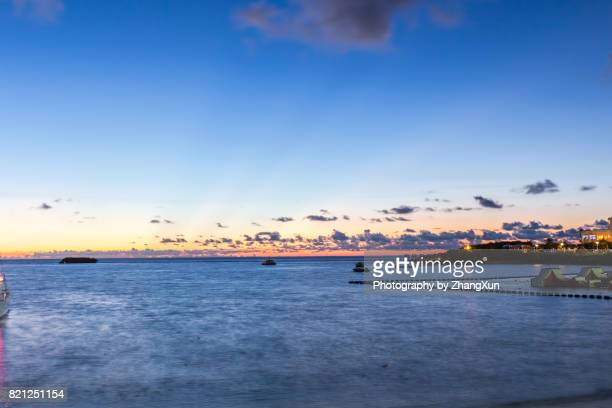 Okinawa sunset skyline at Manza beach with the background of  sea and Sky, Naha, Okinawa, Japan.