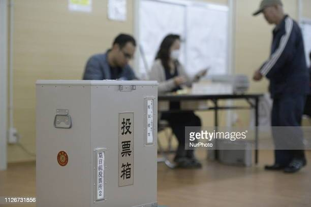 Okinawan people cast their ballots in the prefectural referendum on the planned relocation of aUS militarybase at a polling station on February 22,...