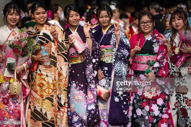 Okinawan women in a kimonos pose for photographs after attending a ceremony on Coming of Age Day on January 13, 2019 in Okinawa City, Japan. Coming...