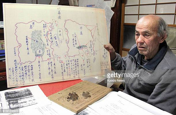Okinoshima Japan Shoza Yawata shows materials he has collected regarding the ownership of a group of islets in the Sea of Japan called Takeshima by...