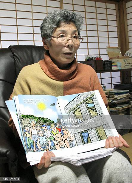 Okinoshima Japan Yumiko Sugihara holds a picture book she has completed in the town of Okinoshima Shimane Prefecture on Jan 22 2013 The book tells...