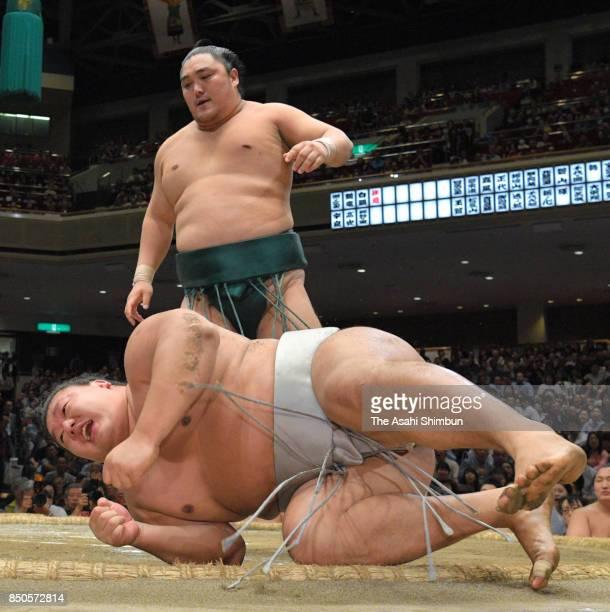 Okinoumi throws Mongolian wrestler Takanoiwa to win during day twelve of the Grand Sumo Autumn Tournament at Ryogoku Kokugikan on September 21 2017...