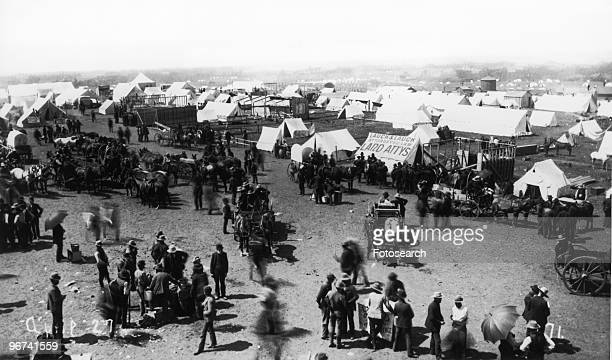 Oklahoma Avenue looking west Guthrie Oklahoma photographed by Mitchell and DeGroff showing crowds and tents Guthrie Oklahoma USA 27 April 1889
