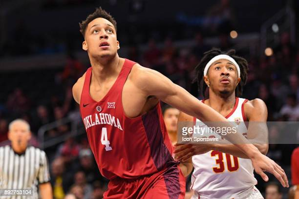 Oklahoma center Jamuni McNeace boxes out USC guard Elijah Stewart during an college basketball game between the Oklahoma Sooners and the USC Trojans...